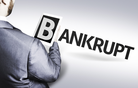bankrupt: Business man in low angle view with the text: Bankrupt