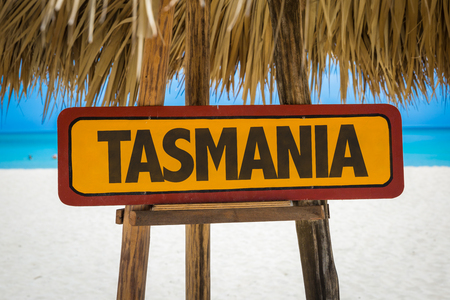 tasmania: Wooden sign board in beach with text: Tasmania Stock Photo