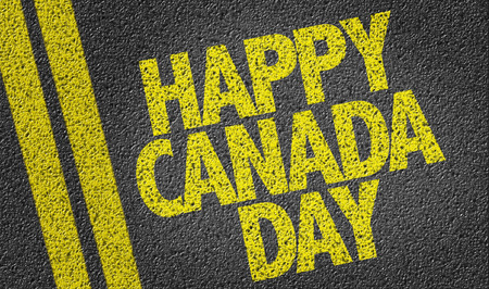 Text on tar road: Happy Canada Day
