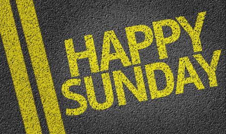 Text on tar road: Happy Sunday