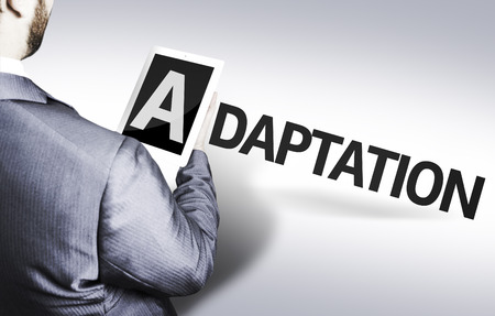 adaptation: Business man in low angle view with the text: Adaptation Stock Photo
