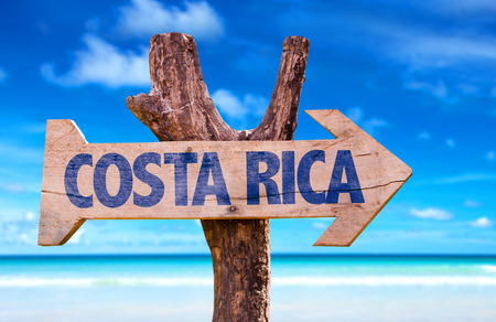 Costa Rica sign with arrow on beach background