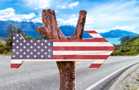 USA flag sign with arrow on road background