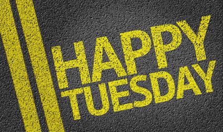 Text on tar road: Happy Tuesday Stock Photo