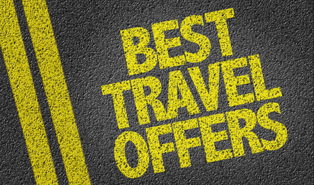 Text on tar road: Best travel offers