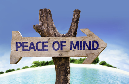 Peace of mind sign with beach background Stock Photo