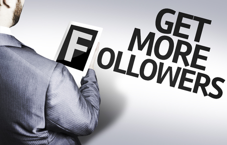 followers: Business man in low angle view with the text: Get more followers Stock Photo