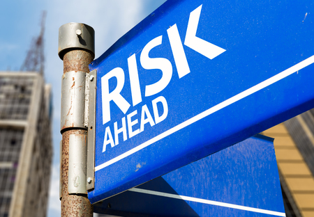 volatility: Risk ahead signpost on building background Stock Photo