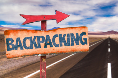 backpacking: Backpacking sign with arrow on road background