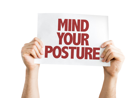 Hands holding cardboard on white background with text: Mind your posture Stock Photo