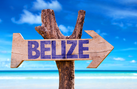 Belize sign with arrow on beach background