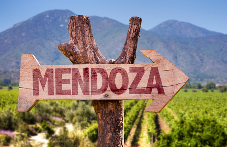 Wooden sign board in park with text: Mendoza