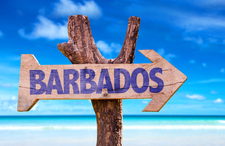 Barbados sign with arrow on beach background