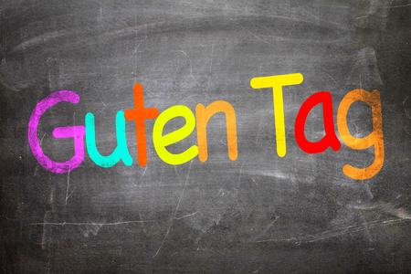 guten tag: Guten tag (good day in German) written on blackboard