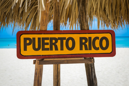 puerto rico: Wooden sign board in beach with text: Puerto Rico