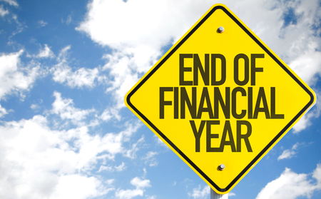 End of financial year sign with clouds and sky background