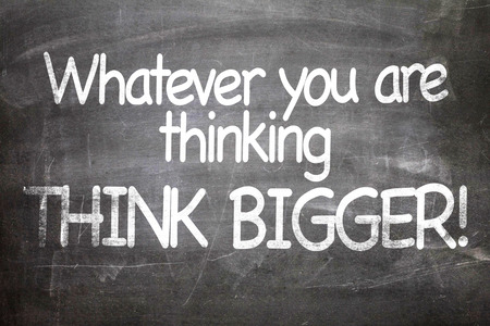 thinking of you: Whatever you are thinking think bigger! written on blackboard