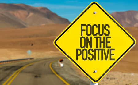 Focus on the positive sign with desert background