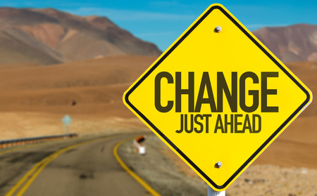 challenges ahead: Change just ahead sign with desert background