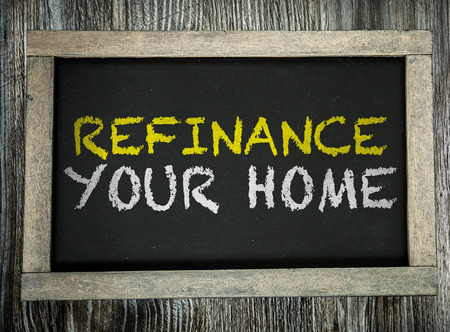 refinancing interest rates: Refinance your home written on blackboard