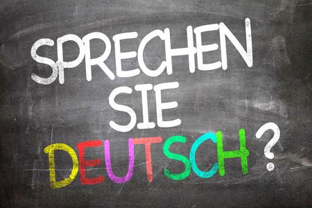deutsch: Sprechen sie deutsch? (Do you speak German? in German) written on blackboard