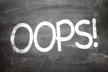 darn: Oops! written on blackboard Stock Photo