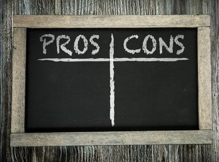 pros: Pros cons written on blackboard