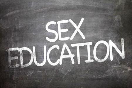 sex education: Sex education written on blackboard Stock Photo