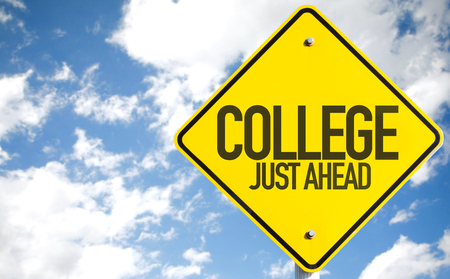 College just ahead sign with clouds and sky background Stock Photo