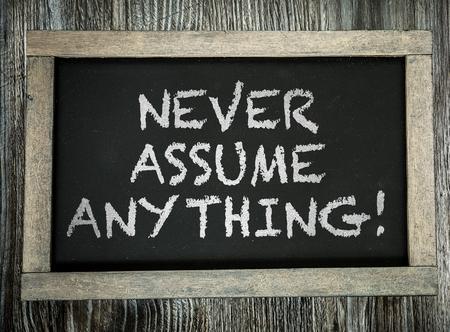 Never assume anything! written on blackboard