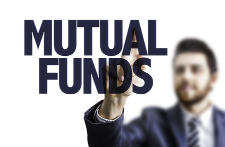financial diversification: Business man pointing to transparent board with text: Mutual funds