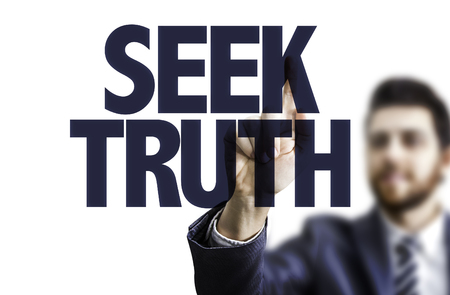 morality: Business man pointing to transparent board with text: Seek truth Stock Photo