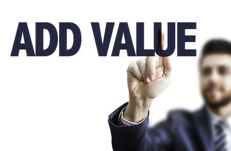 value add: Business man pointing to transparent board with text: Add value Stock Photo