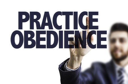 obediencia: Business man pointing to transparent board with text: Practice obedience