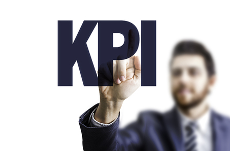 kpi: Business man pointing to transparent board with text: KPI