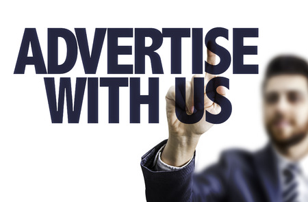 advertise with us: Business man pointing to transparent board with text: Advertise with us Stock Photo