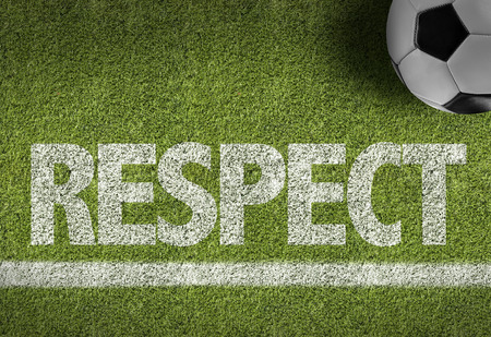 courteous: Text on soccer field: Respect Stock Photo