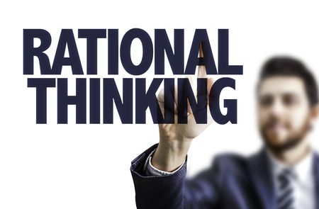 rational: Business man pointing to transparent board with text: Rational thinking