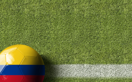 Colombia flag ball on soccer field background Stock Photo