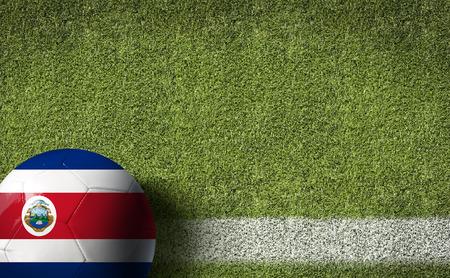 bandera de costa rica: Costa Rica pabellón pelota en el fondo del campo de fútbol Foto de archivo
