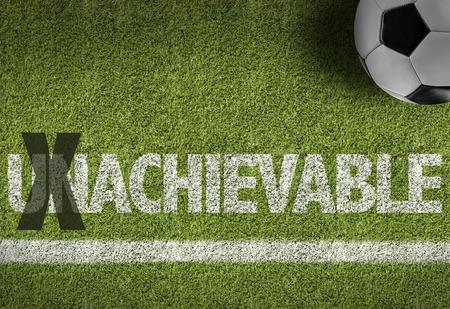 achievable: Text on soccer field: Achievable