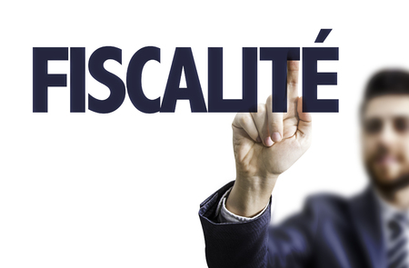 テキストに透明な板を指すビジネス男: Fiscalite (フランスの税制) 写真素材