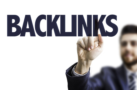 linkbuilding: Business man pointing to transparent board with text: Backlinks