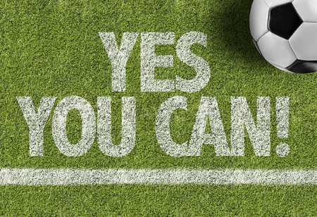 tu puedes: Text on soccer field: Yes you can!