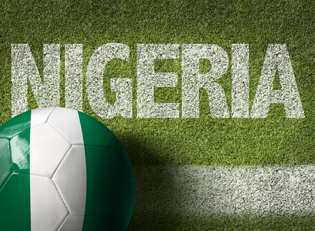 country nigeria: Text on soccer field: Nigeria Stock Photo