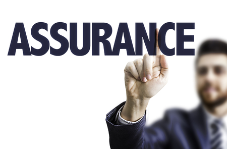Business man pointing to transparent board with text: Assurance