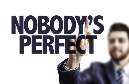perfectionist: Business man pointing to transparent board with text: Nobodys perfect