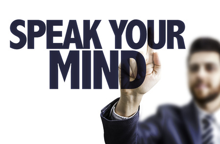 commenting: Business man pointing to transparent board with text: Speak your mind Stock Photo
