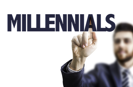 Business man pointing to transparent board with text: Millennials