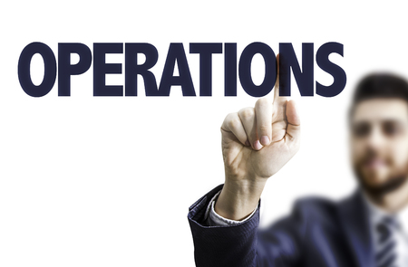 overseeing: Business man pointing to transparent board with text: Operations